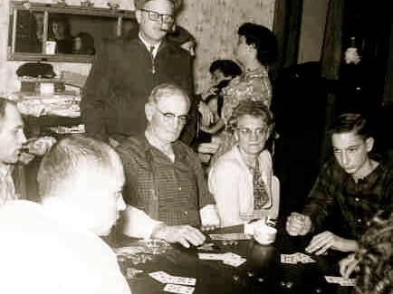 Cards go way back in Family History. Here we see the Henrys deeply involved in poker. And maybe some plum wine