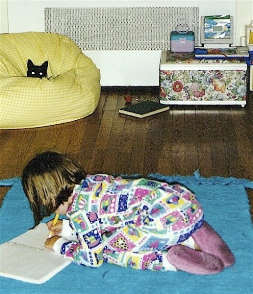 Here is The Child, writing (perhaps in this journal?) while tuna watches from the safety of the beanbag chair