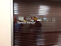 Ronald McDonald peeks out from General Manager Mike Swoboda's office.