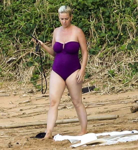 Katy Perry flaunts her trim post-pregnancy figure while vacationing in Hawaii with fiance Orlando Bloom (photos)