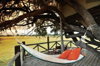 #3 The Hide's Dove Nest: Zimbabwe Many are filled with child-like glee as they board a plane, knowing they are going somewhere special. That child-like feeling never leaves when you arrive in Hwange National Park to stay at The Hide's Dove Nest (thehide.com). The multi-level tree house emanates a fort you may have played in as a kid, including a wooden stairway and trap door. (Who was lucky enough to have a tree house fort with a trap door?!?)Positioned in a leadwood tree, the first floor is a viewing platform, the level from which a visitor will need your permission to enter the higher level bedroom. (Or, would you require a password?) While staying here, swing lazily in the hammock as you keep an eye out for any of the 100 plus mammal species that live in the park.Photo credit: The Hide