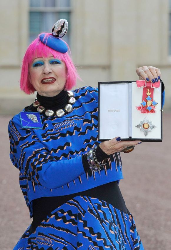 British fashion designer Zandra Rhodes holding her Dame Commander of the Order of the British Empire medal presented to her by the Princess Royal at an Investiture ceremony at Buckingham Palace in central London on February 13, 2015. AFP PHOTO / POOL / NICK ANSELL / AFP PHOTO / POOL / Nick Ansell