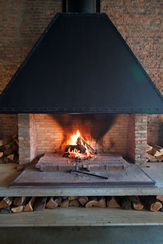 The bar and main restaurant reside on the first floor sharing a massive wood burning fireplace