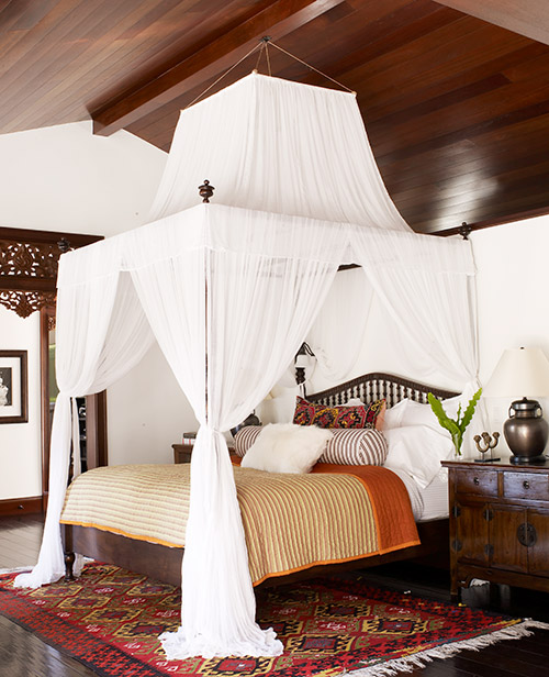"Kid Rocks' custom ""Harbour Island"" bed draped in white muslin."