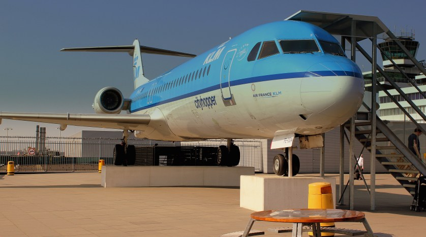 KLM Fokker 100 on the Panorama Roof Terrace at Amsterdam Airport Schiphol. Photo by Calflier