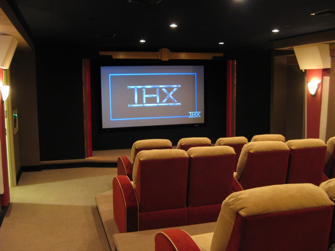 Residents of the Bellamy have access to their own theater room. (Photography hometheatergallery.com)