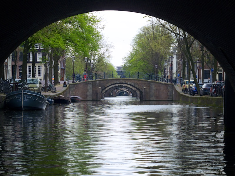 One-way traffic moves along either side of the canals that are crisscrossed by many bridges