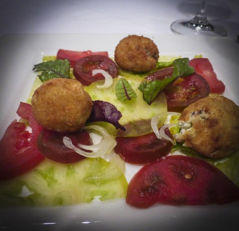 Tomato Carpaccio with ricotta cheese croquette, prosciutto and marjoram pesto (Photo by Sandra Chambers)