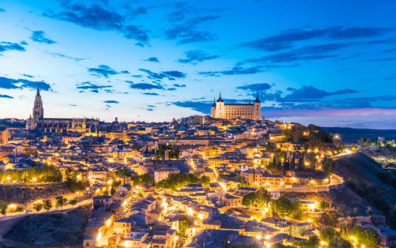 view_of_toledo_spain_including_alcazar_and_the_cathedral_at_dusk