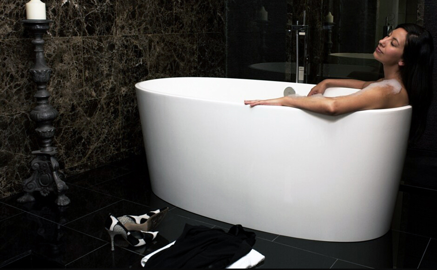 Victoria + Albert Ios bath in volcanic limestone is distributed in Quenesland by Luxe by Design, Brisbane.