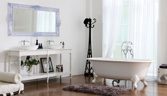 Victoria + Albert Raford traditional bath in volcanic limestone is distributed in Quenesland by Luxe by Design, Australia.