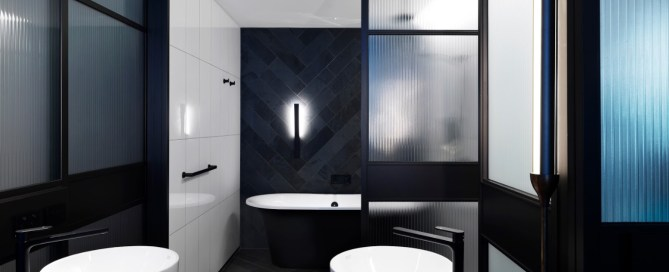 QT Melbourne Hotel features Victoria + Albert Monaco matte black freestanding bath, imported and supplied by Luxe by Design Australia.