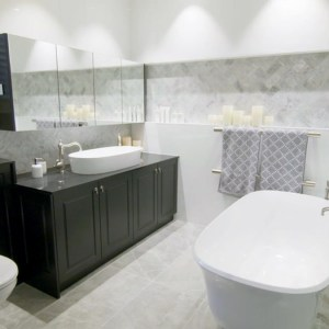 Shaynna Blaze Deadline Design Blackburn Bathroom - Victoria and Albert Amiata bath and Ios 80 basin. Marble and Black bathroom.