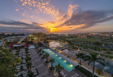 LuxeGetaways - 25 Poolside Experiences - Luxury Hotel Pools - Sheraton Puerto Rico - hotel at sunset