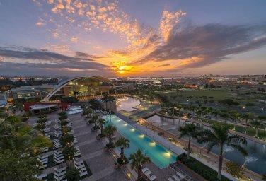 LuxeGetaways - 25 Poolside Experiences - Luxury Hotel Pools - Sheraton Puerto Rico - hotel at sunset