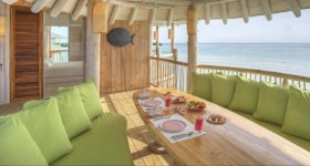 LuxeGetaways - Luxury Travel - Luxury Travel Magazine - Luxe Getaways - Luxury Lifestyle - Luxury Villa Rentals - Affluent Travel - Soneva Jani Water Villas - Medhufaru Island - Republic of Maldives - dining on patio