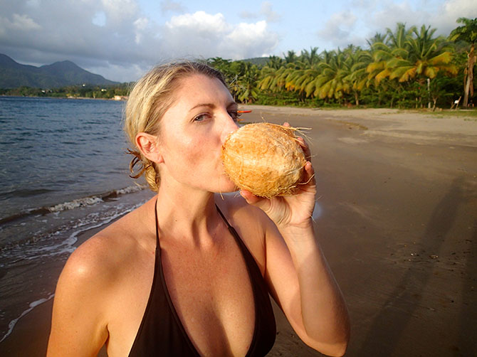 Secret Bay beach - Drinking out of coconuts