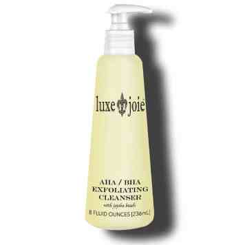 aha bha exfoliating cleanser with jojoba beads on white background
