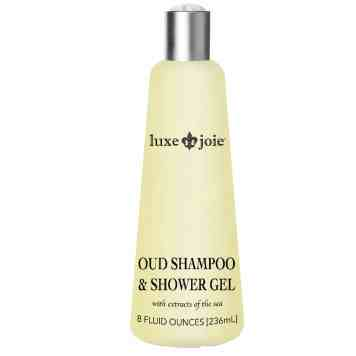 oud shampoo and shower gel on white background