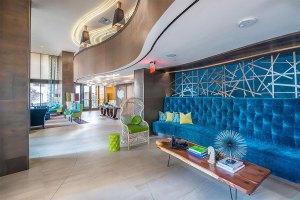 Community Area Couch at The Taylor Apartments in Uptown Dallas TX Lux Locators Dallas Apartment Locators