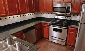 Kitchen at Riviera at West Villiage Apartments in Uptown Dallas TX Lux Locators Dallas Apartment Locators