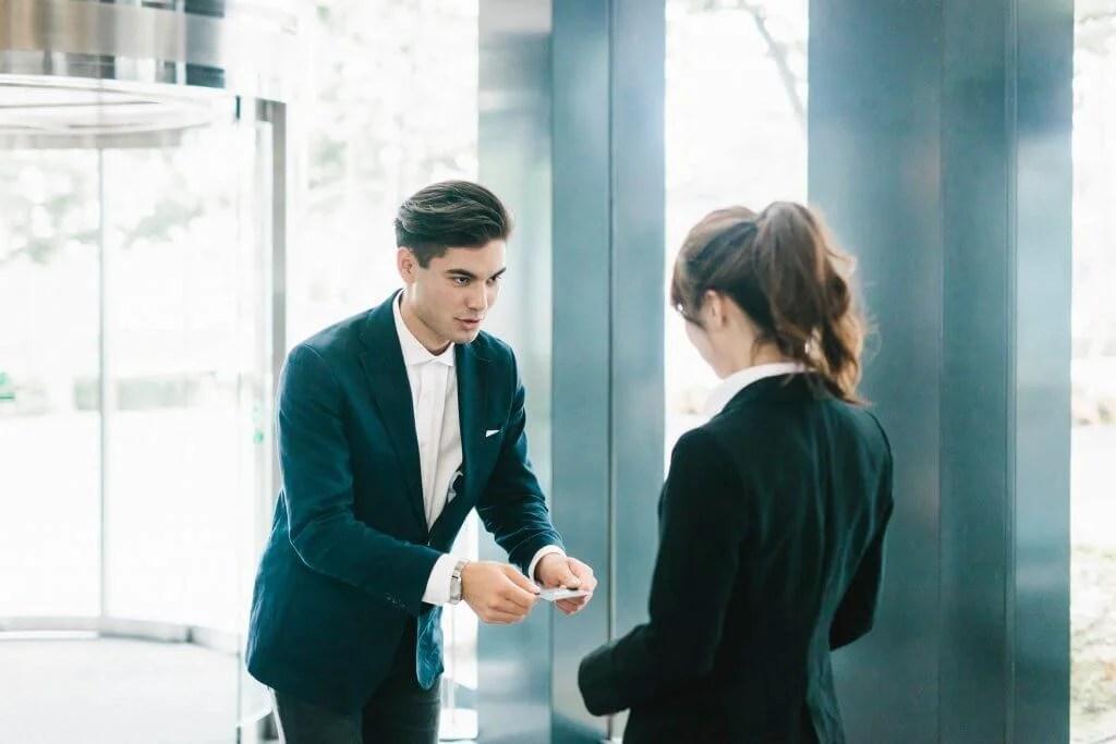 Business Man handing woman business card
