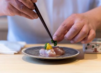 Sushi Shin Niseko Chef Plating a Kinmedai Appetizer in Annupuri Village Niseko on LuxNiseko Alpine Luxury Lifestyle Magazine