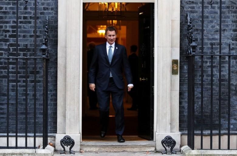FILE - Britain's Foreign Secretary Jeremy Hunt leaves 10 Downing Street, London, Britain, Nov. 13, 2018.