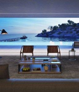 De glidende vægge gør stuen til en integreret del af husets store terrasse, så udsigten kan nydes i fulde drag.