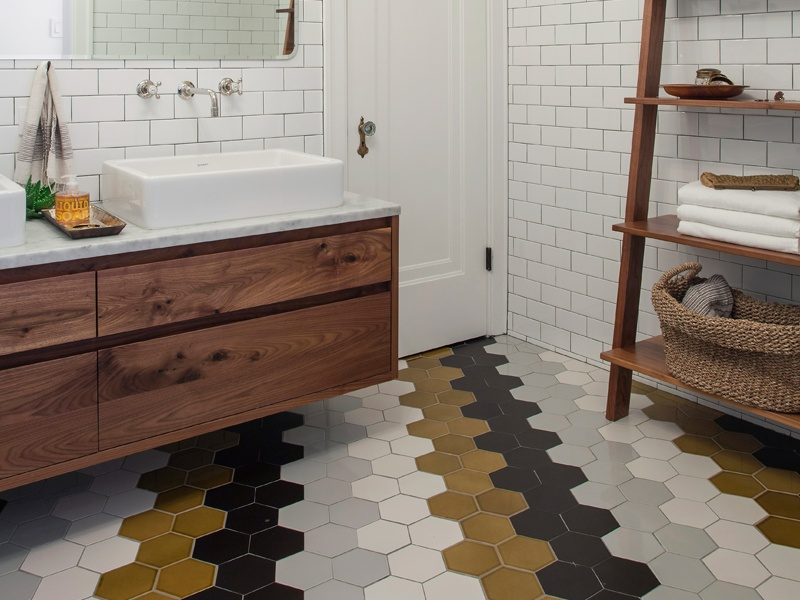 Hand-glazed and characterized by a midcentury aesthetic, Heath Ceramics' tiles provide endless opportunities for creative, custom designs – such as this mix-and-match concept by Stacia Garriott Kass for her vintage store, Sojourn, in Sawyer, Michigan. Photograph: Mike Schwartz