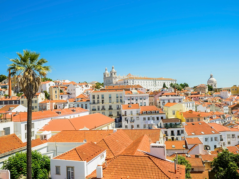 The Alfama district in Lisbon is made up of narrow streets, tiny squares, churches, and whitewashed houses. Photograph: Getty Images
