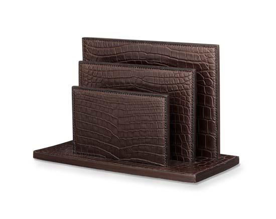 """Hermes vertical folder in black matte alligator leather. Measures 7"""" x 11.8"""" Ref. H046617CA89 $37,400.00"""