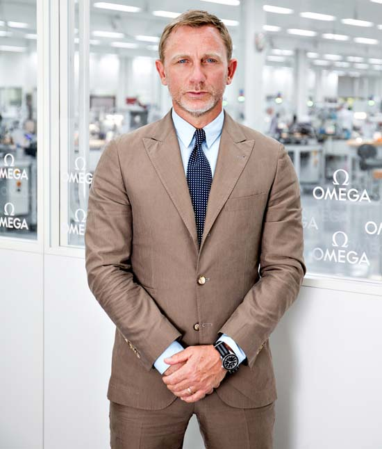 "Daniel Craig at the Omega factory in Villeret, wearing the Omega Seamaster 300 ""Spectre"" limited edition"