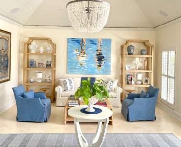 Coffee table by Palecek; raffia étagères by Barclay Butera; sofa by John Rosselli & Associates