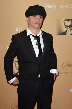 Olivier Dahan wearing a black shawl collar silk satin tuxedo, a white cotton poplin shirt and a black silk tie.