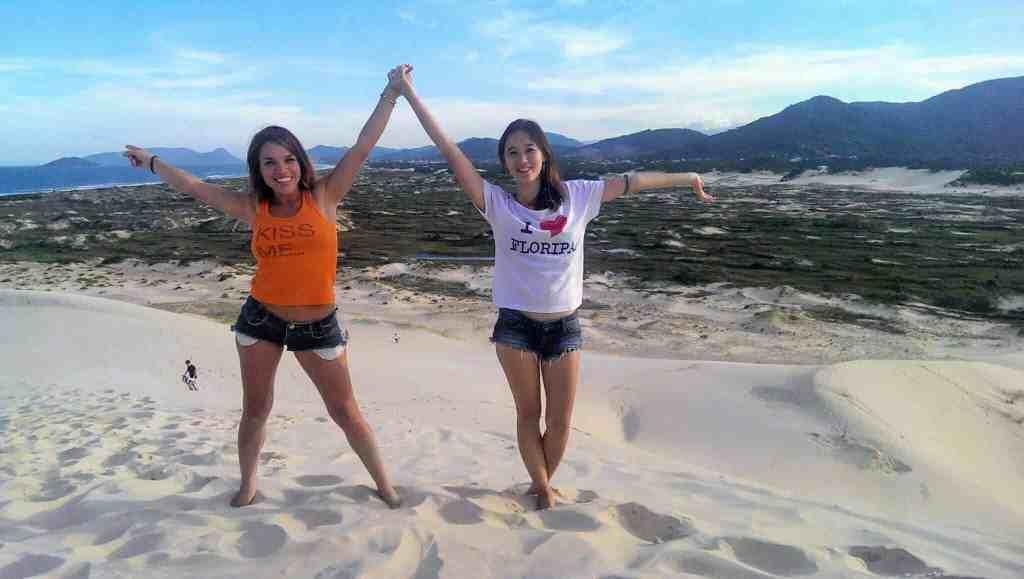 5 Reasons To Visit Florianópolis, Brazil - Dunas da Joaquina Posing - The Traveller's Guide By #ljojlo