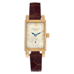 Vintage Patek Philippe Classic in 18k with off white dial. Manual w/ sub seconds
