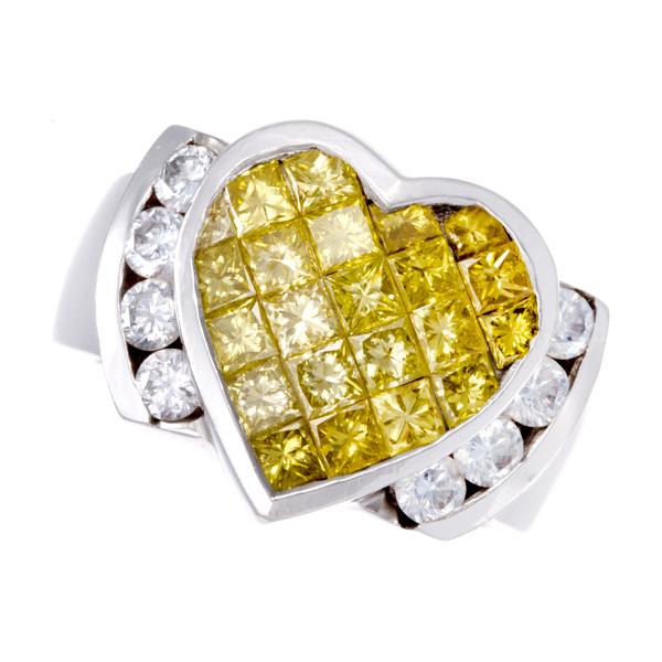 Diamond heart ring in 18k white gold. 2.00 carats in diamonds. Size 4.5