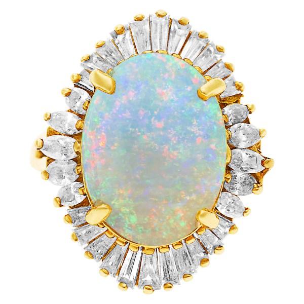 Australian opal ring in 18k with diamonds. 5.00 carats in rainbow fire opal