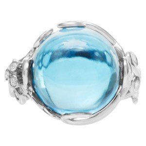 Funky Blue topaz ring in 18k white gold with diamond accents. Size 7.25.