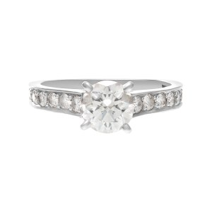 Cartier GIA certified 1.01cts round brilliant cut center diamond (F color, Internally Flawless clarity, Excellent Cut, Excellent polish, Excellent symmetry)  engagement ring in platinum. Size 6