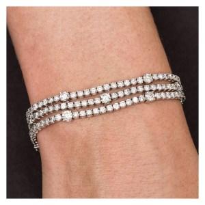 Sparkling three line diamond bracelet in 18k white gold. Approx. 12.30 carats in Diamonds.