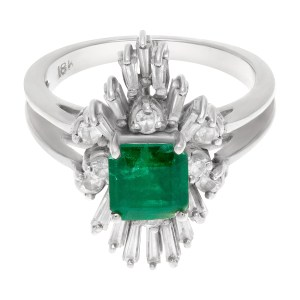 Emerald ring with diamond accents in 18k white gold