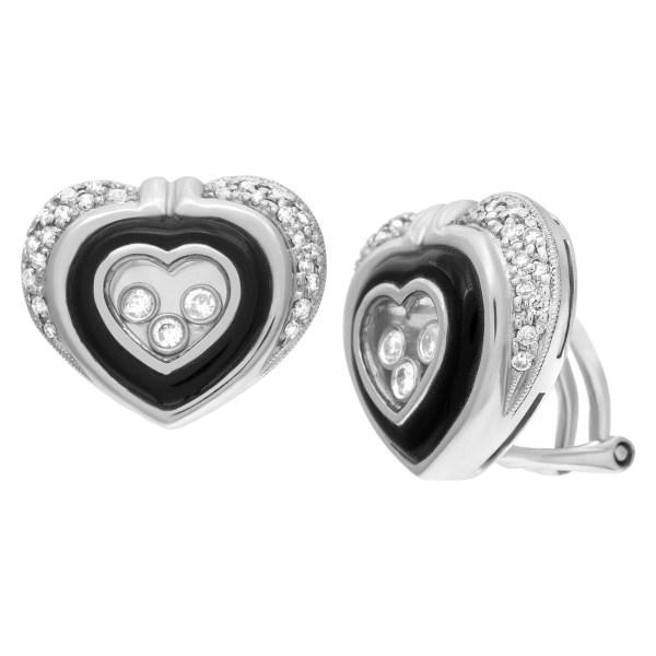 Heart shaped diamond earrings in 14k white gold w/ floating diamonds w/ approx. 0.80 cts in diamonds