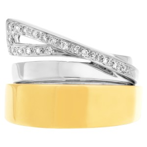 Interesting ring in 18k white and yellow gold with diamond swirl
