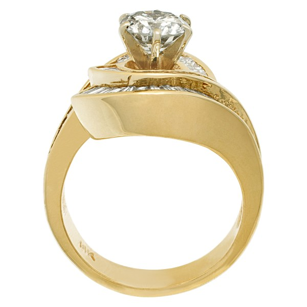 GIA certified round brilliant cut diamond 1.02 carat (S to T range, Light Brown, I1 clarity) ring with over 1.50 carat in baguette diamonds