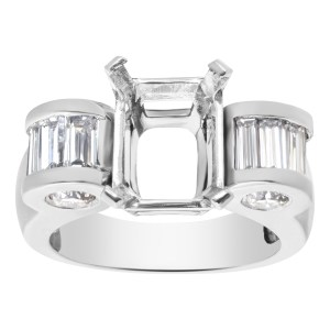 Unusual Setting for approx 2 to 2 1/2 carat Emerald cut stone in Platinum with approx 1 carat round and bsaguette cut stone.