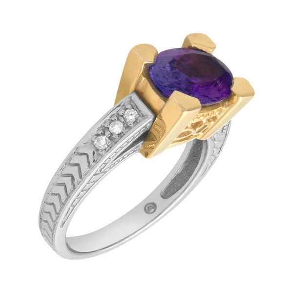 Tanzanite ring (1.50 cts) with diamond accents in 14k white and yellow gold
