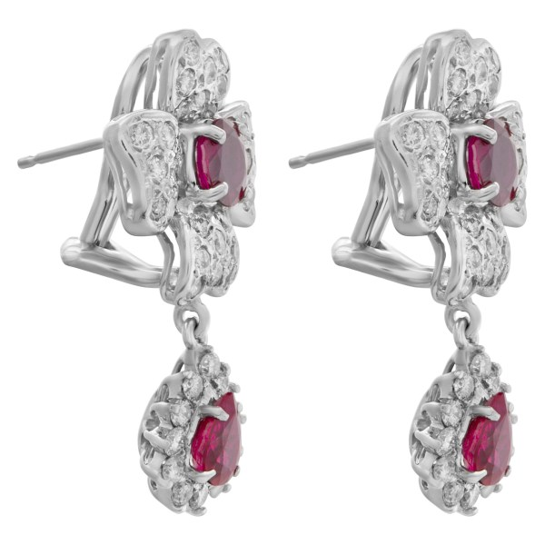 Diamond and ruby floral design earrings in 18k white gold.