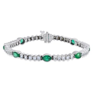 Diamond and emerald eternity bracelet in 14k white gold
